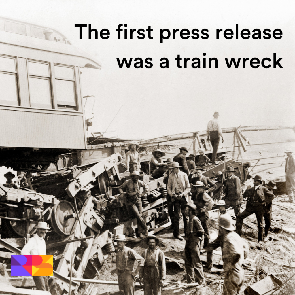 The first press release was a train wreck. Text overlaid on an early black and white photograph of a railway accident.