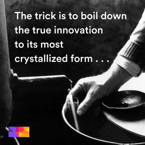 """The quote """"The trick is to boil down the true innovation to its most crystallized form"""" overlaid on an old black and white photograph of a distillery."""